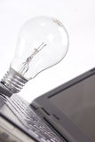 Light bulb on a notebook. Royalty Free Stock Images