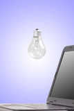 Light bulb and notebook. Royalty Free Stock Photo
