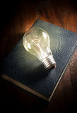 Light bulb on old book. Royalty Free Stock Photography