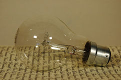 Light bulb on old letter Royalty Free Stock Photo