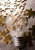 Light Bulb On Jigsaws Stock Photos