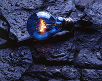 Free Light Bulb On Wet Rocks Stock Photography - 5986892