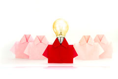 Light bulb in One Red among white origami shirt paper , unique i Royalty Free Stock Images