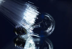 Light bulb with optic fiber Stock Images