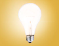 Light bulb on orange background Stock Photo