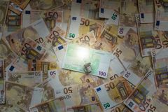 Light bulb over euro banknotes. Concept of bussines idea. Light bulb over euro banknotes. Concept of money making ideas. Convert ideas into cash. Conceptual Royalty Free Stock Photos