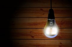Light bulb over wooden background Stock Images