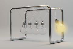 Light bulb pendulum idea concept Stock Photo