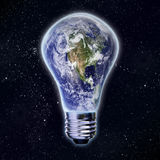 Light bulb and planet earth Stock Image