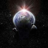Light bulb and planet earth. Eco Energy concept Stock Photos