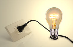Light bulb and a plug Stock Photo