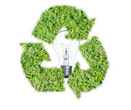 Light bulb protected by recycle green grass logo Stock Photography