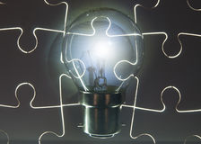 Light bulb puzzle Royalty Free Stock Photo