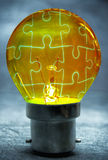 Light bulb puzzle. Jigsaw puzzle solution inside a light bulb Stock Photo