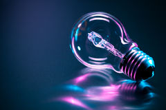 Light bulb reflecting colors Royalty Free Stock Photography