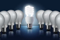 Light bulb in row with middle one turn on Stock Photo
