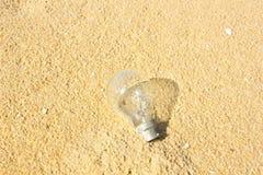 Light bulb on sand Stock Photos