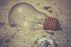 Light bulb in the sand Stock Photography