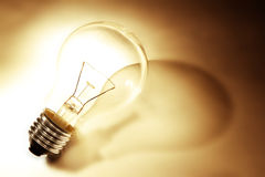 Light bulb. And shadow, warm tone stock photo