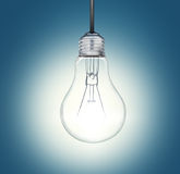 A light bulb shines in the darkness bright light Royalty Free Stock Photos