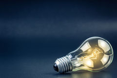Light bulb. Shining with copy space Stock Image