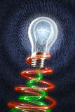Light Bulb shining on jeans. Creativity concept. E Stock Image