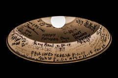 Light bulb showing the patrons names. Ceiling light marked with the name of all patrons that visited Alaska dinner. This light bulb shows the travelers Royalty Free Stock Photography