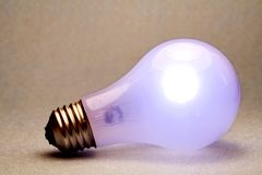 Light Bulb side. A shot of a glowing light bulb Royalty Free Stock Image