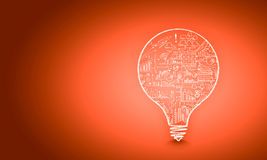 Light bulb with sketches Stock Photos