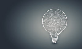 Light bulb with sketches Royalty Free Stock Photos