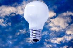 Light bulb on sky, concept of creativity/success. Creativity and success, represented by a light bulb on blue sky Royalty Free Stock Images
