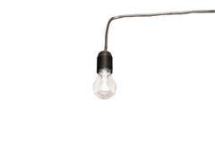 Light bulb in the socket. Old light bulb in the socket stock photo