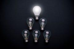 Light bulb solution. On black background concept stock images