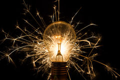 Light bulb with sparkles from behind Stock Photo