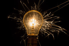 Light bulb with sparkles from behind Royalty Free Stock Photos