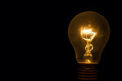 Light bulb with sparkles from behind Royalty Free Stock Photo
