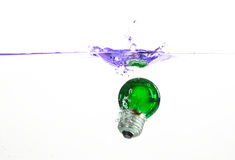 Light bulb splash. Green light-bulb dropped in water Stock Photography