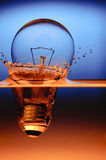 Light bulb and splashing water Stock Image