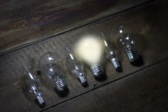 A light bulb that stable and glowing among the others.  Royalty Free Stock Images