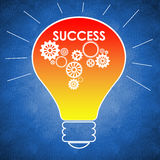 Light bulb with success written on it Stock Images