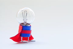 Light bulb in super hero costume. Skillful, expert man original concept. Vintage lamp with ideal spherical surface and. Light bulb in superhero costume. Skillful stock photography