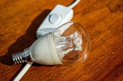 Light bulb and switch Royalty Free Stock Photo