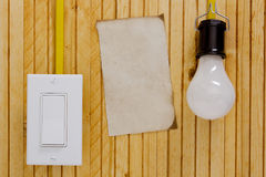 Light bulb switch wall Stock Photography