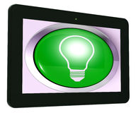 Light bulb Tablet Means Bright Idea Innovation Or Invention Royalty Free Stock Images
