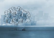 Light bulb tree over cityscape Royalty Free Stock Images
