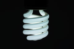 Light bulb turn on. With black background Stock Images