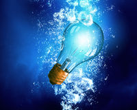 Light bulb under water Stock Images