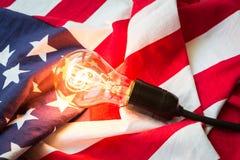 Light bulb on USA flag Royalty Free Stock Photos