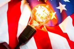 Light bulb on USA flag Royalty Free Stock Photography