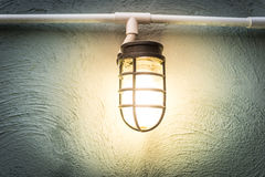Light bulb on the wall Royalty Free Stock Photo